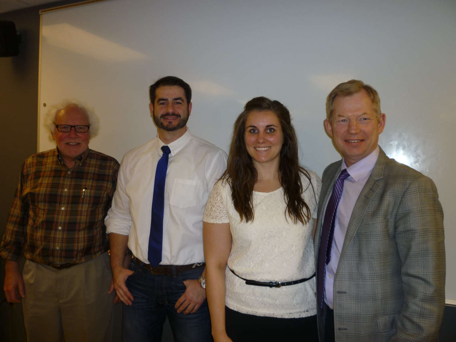 Jessica with her Master's thesis committee after her successful defense on April 14.