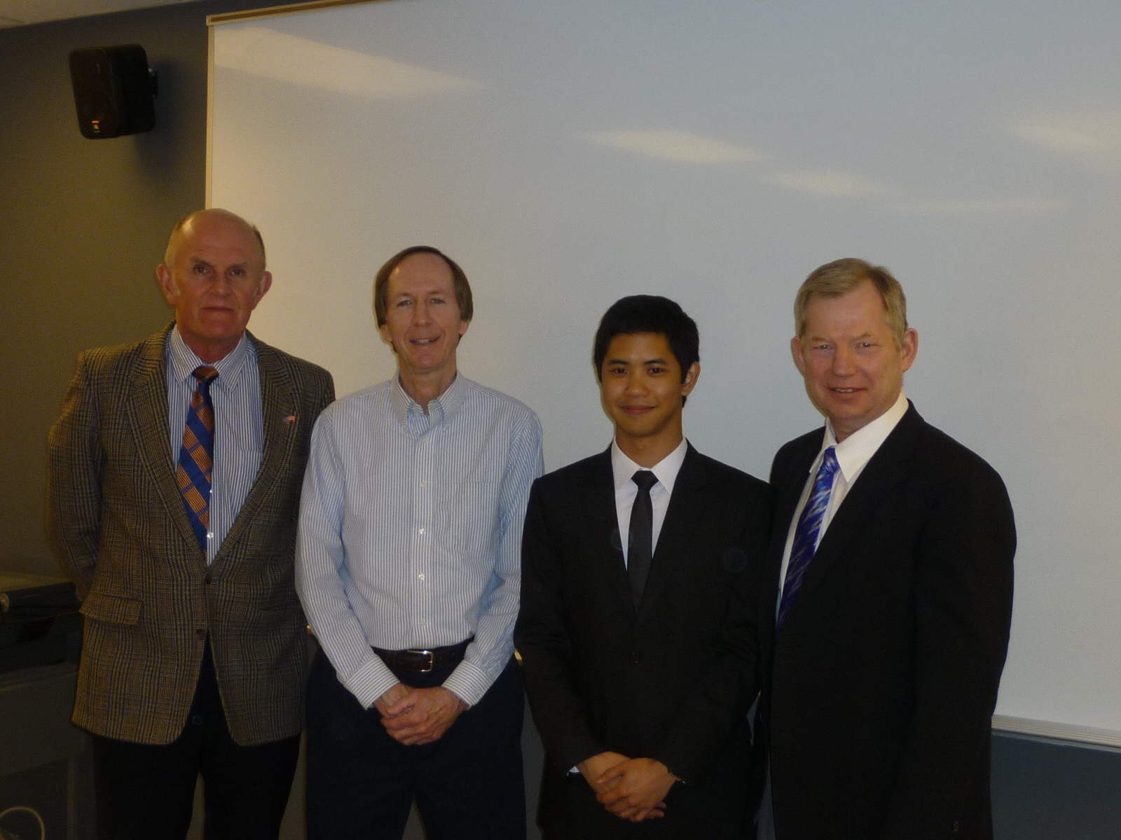 Diego with his Master's thesis committee after his successful defense on April 17.